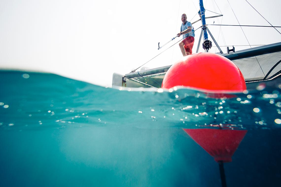 Catamaran picking up a buoy with a mooring ball hook, Polyform CC Buoy Red